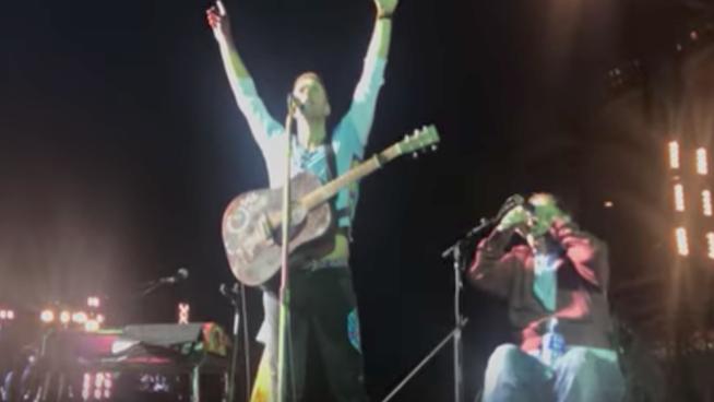 Chris Martin invites crowd surfing Dublin fan in wheelchair onstage