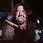 Dave Grohl chugs a beer, falls off the stage in Vegas