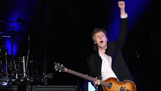 "Ringo Starr joins Paul McCartney and Ronnie Wood from the Rolling Stones on stage to perform ""Get Back"""