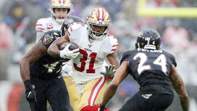 Running in the rain: Ravens outlast 49ers in ground game slugfest