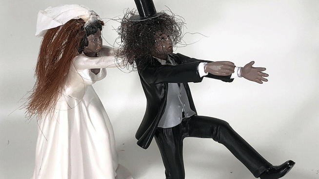 Guns N' Roses wedding cake topper comes with pieces of Slash's real hair