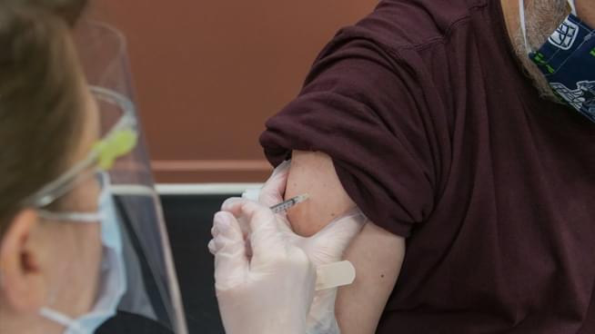 California opens scarce vaccines to those 65 and older