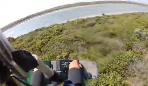 Kitesurfer Jumps Across Island