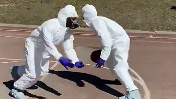 New York Friends Play Basketball In Hazmat Suits