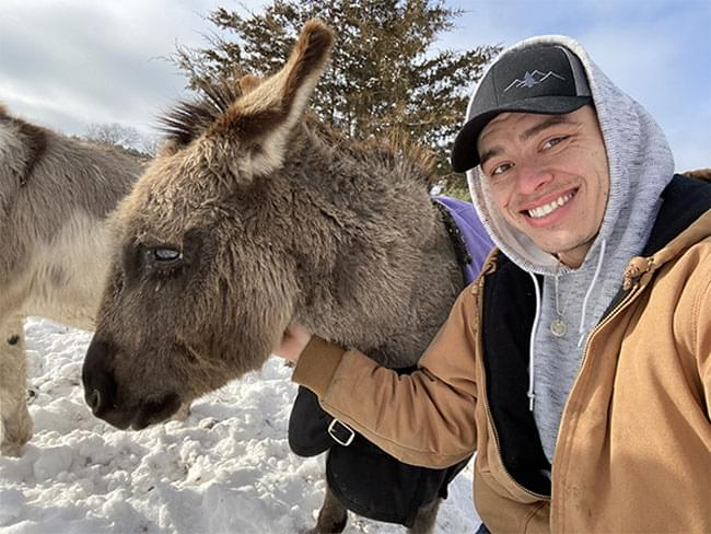 Tim and one of his pet donkeys
