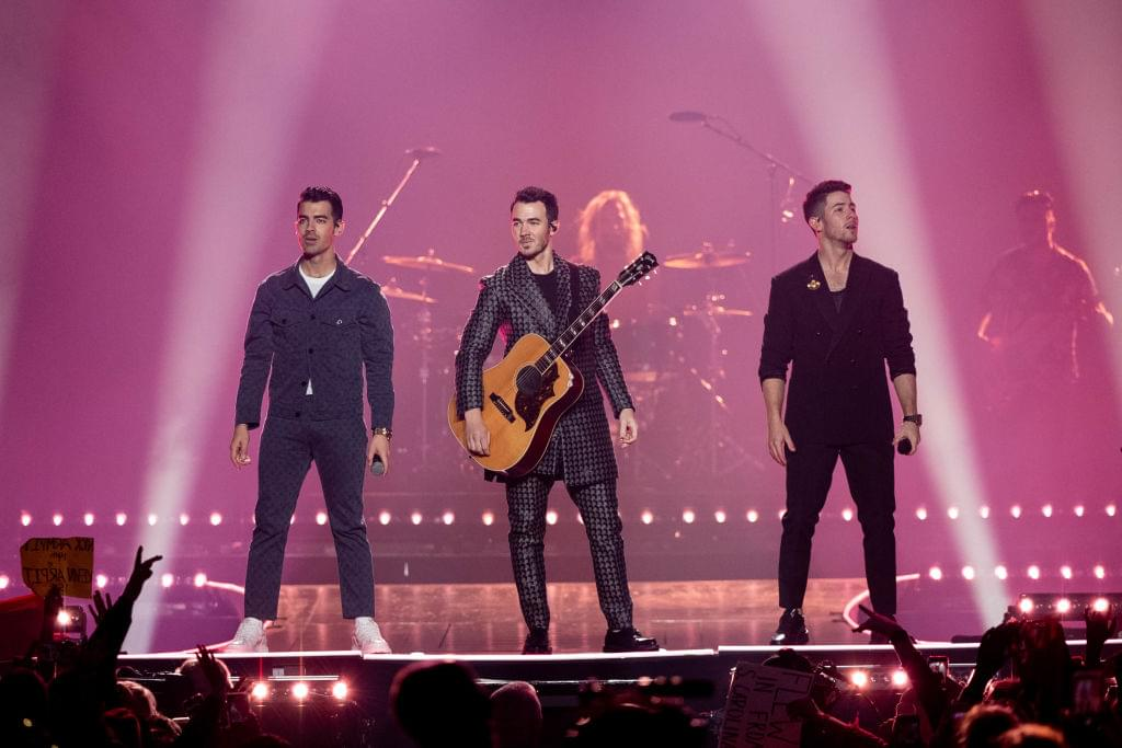 Jonas Brothers Ride Through Vegas In Alternate Video for 'What A Man Gotta Do' | Q-Daily