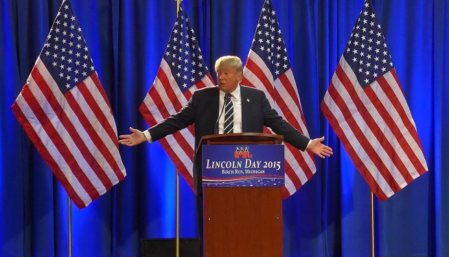 Donald Trump speaks to the media at a Lincoln Day event sponsored in Birch Run, Michigan.