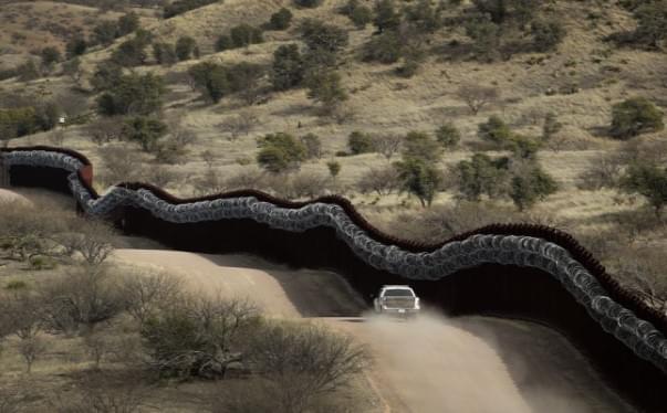 Biden halts border wall building after Trump's final surge
