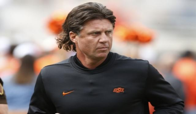 Oklahoma State's Gundy Takes Pay Cut After Fallout From Wearing T-Shirt Promoting OAN
