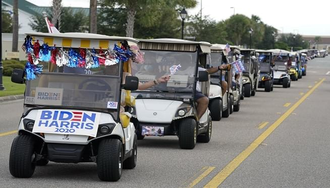 Ahead of Visit By VP Pence, Biden supporters hold golf cart parade