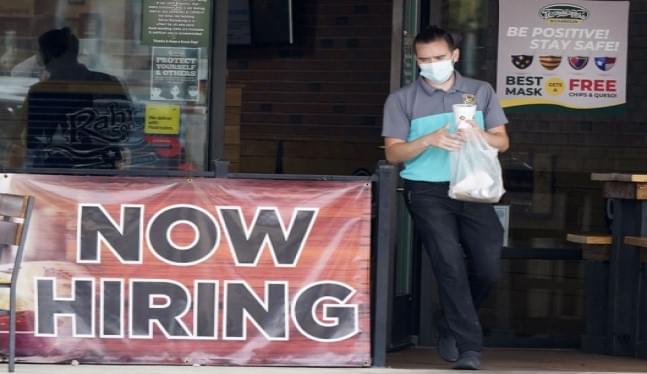 US jobless claims decline to a still-high 900,000