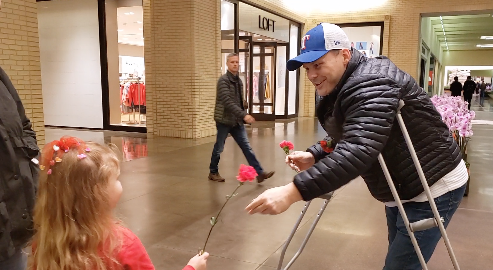 Sid surprises people with flowers at the mall for Valentines Day