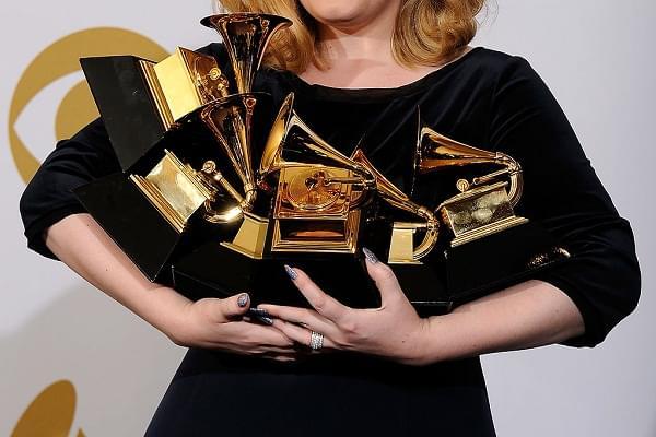 adele holding grammy awards