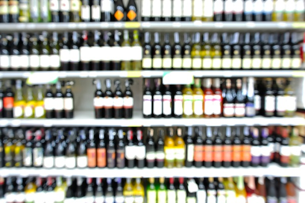 Abstract Blur or Defocus Background of Bottles of Wine on Shelf in Supermarket or Liquor store.