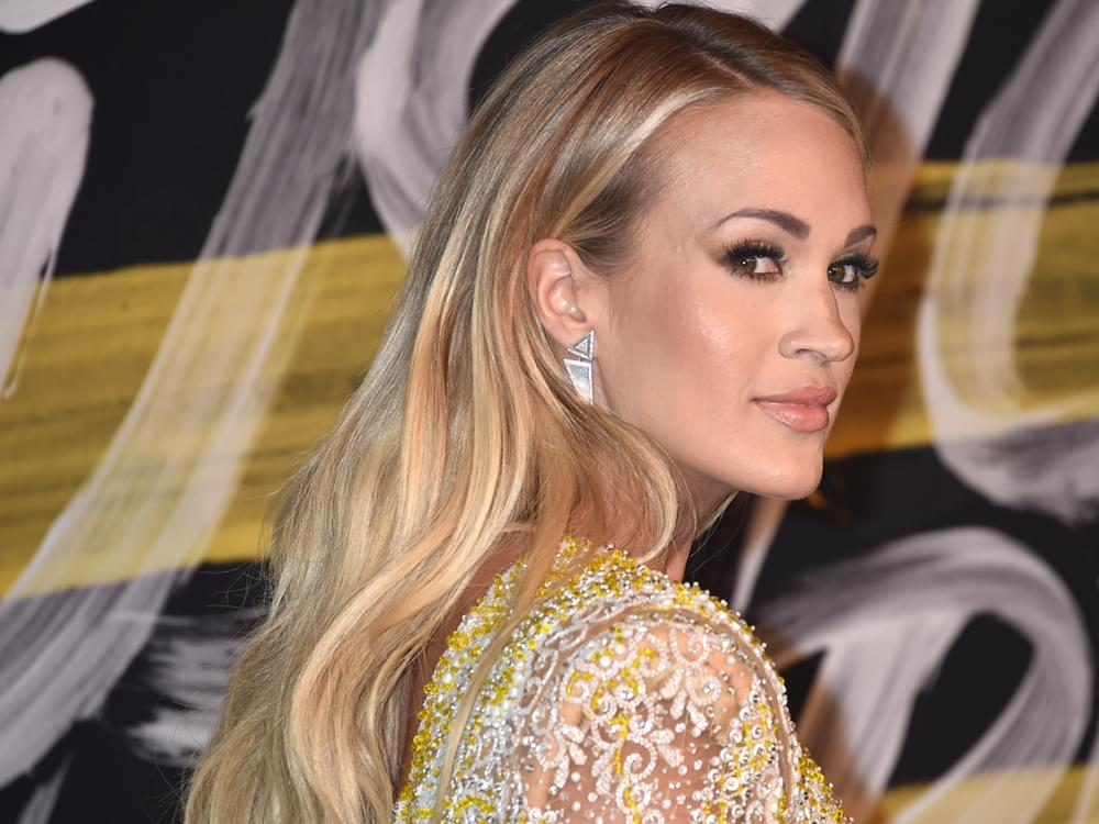 Carrie Underwood & Her Hubby Get Up Close & Personal