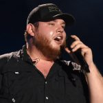 "Watch Luke Combs Get the Girl in Fun-Loving New Video for ""Lovin' On You"""
