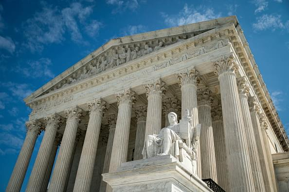 SCOTUS Blocks Attendance Limits in Some Churches Amid Pandemic