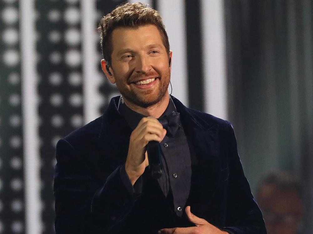 "Brett Eldredge Scores 7th No. 1 Single With ""Love Someone"" [Watch Him Celebrate With Dad]"