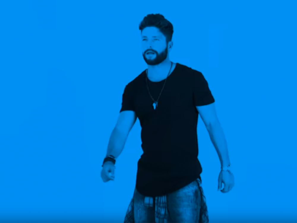"""Feeling Blue? Watch Chris Lane Bust a Move in New Video for """"Let Me Love You"""""""