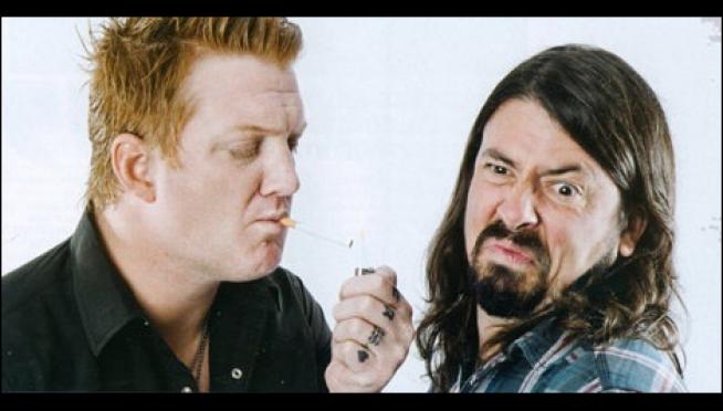 Josh Homme Hangs on Scaffolding to Watch Foo Fighters