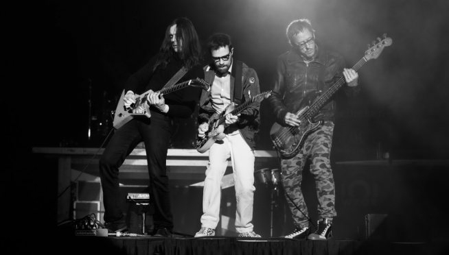 """Weezer is giving """"Buddy Holly"""" the barbershop quartet treatment on tour."""