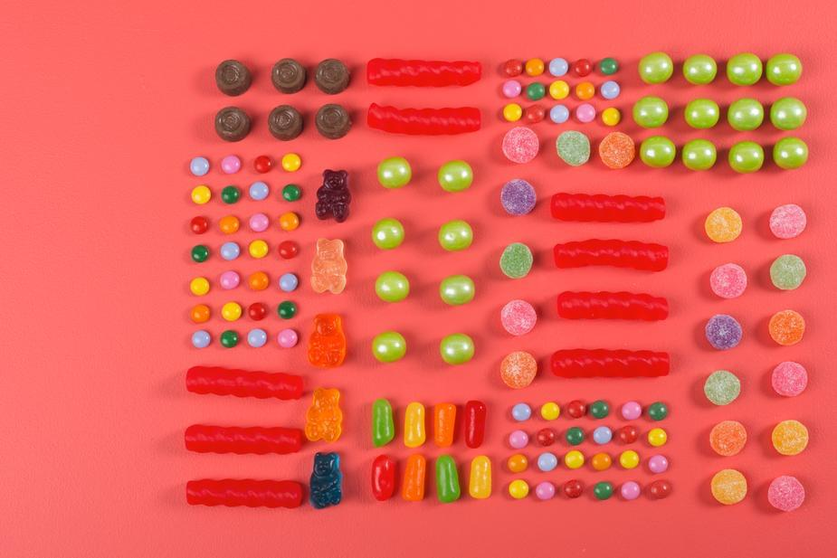 """Man decorates wall with gummy bears after asked to put something up that is """"tasteful"""""""