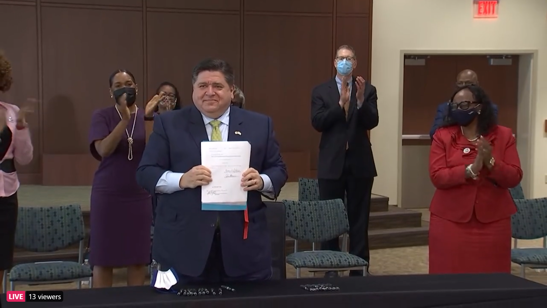 Pritzker signs big expansion of state healthcare programs into law