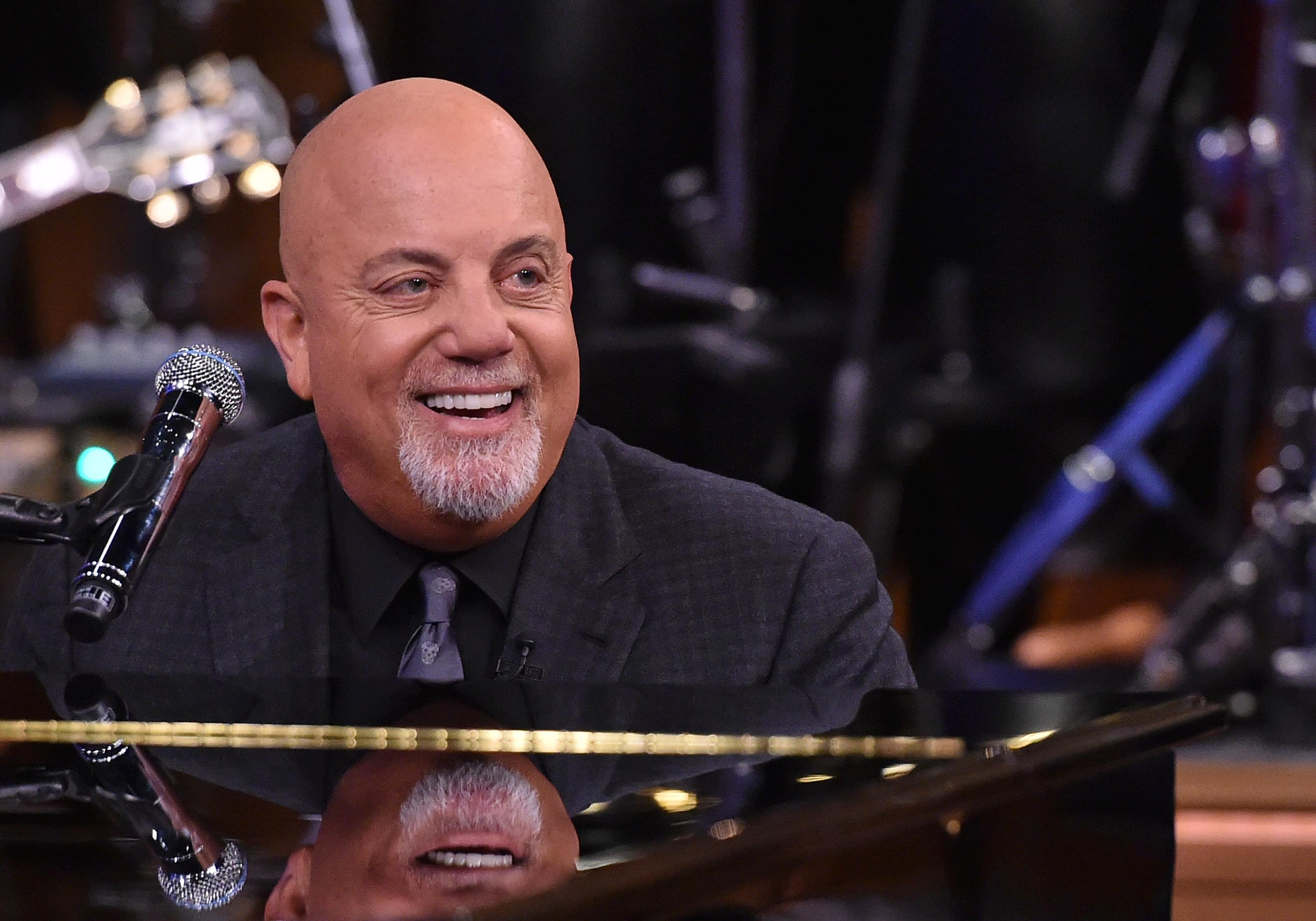 WATCH Billy Joel jamming on a junked piano right on the street