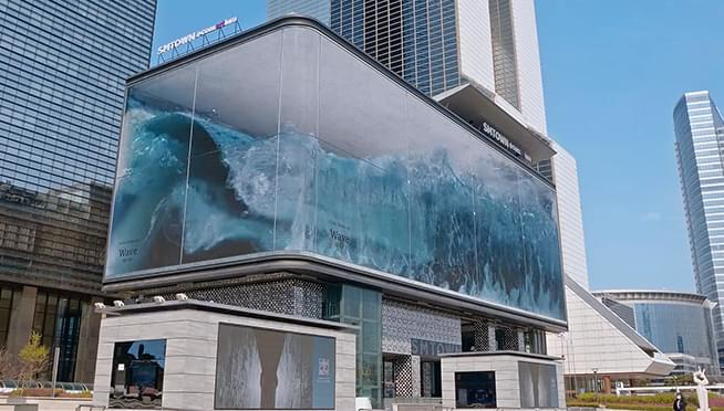 Digital art installation crashes GIANT wave over people