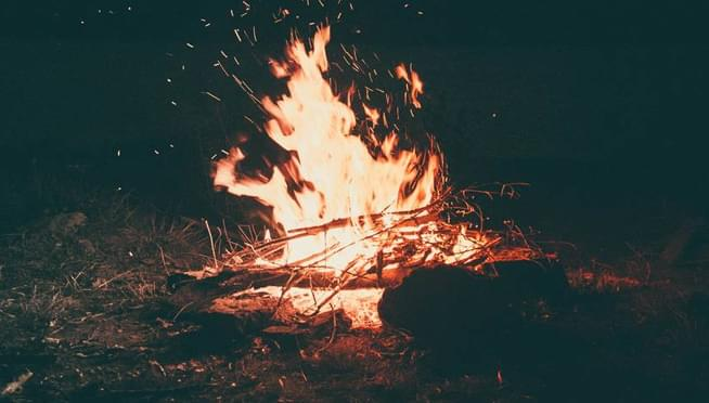 The best old-school summer activities include bonfires, camping, swimming, and sleepovers