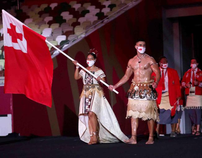 The Shirtless Tongan Flag-Bearer Is Back