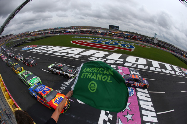 CHARLOTTE, NC - OCTOBER 08:  Matt Kenseth, driver of the #20 Tide Pods Toyota, and Denny Hamlin, driver of the #11 FedEx Office Toyota, lead the field at the start of the Monster Energy NASCAR Cup Series Bank of America 500 at Charlotte Motor Speedway on October 8, 2017 in Charlotte, North Carolina.  (Photo courtesy of NASCARmedia.com/by Sarah Crabill/Getty Images)