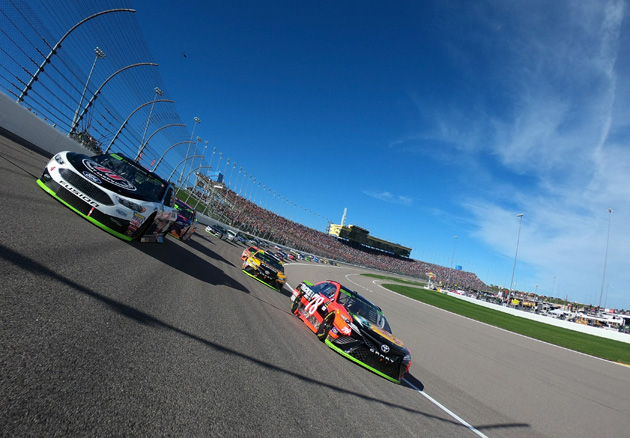 KANSAS CITY, KS - OCTOBER 22:  Martin Truex Jr., driver of the #78 Bass Pro Shops/Tracker Boats Toyota, and Kevin Harvick, driver of the #4 Jimmy John's Ford, lead the field prior to the start of the Monster Energy NASCAR Cup Series Hollywood Casino 400 at Kansas Speedway on October 22, 2017 in Kansas City, Kansas.  (Photo courtesy of NASCARmedia.com/by Jared C. Tilton/Getty Images)