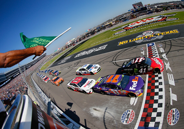 FORT WORTH, TX - NOVEMBER 05:  Kurt Busch, driver of the #41 Haas Automation/Monster Energy Ford, and Denny Hamlin, driver of the #11 FedEx Office Toyota, lead the field past the green flag to start the Monster Energy NASCAR Cup Series AAA Texas 500 at Texas Motor Speedway on November 5, 2017 in Fort Worth, Texas.  (Photo courtesy of NASCARmedia.com/by Jonathan Ferrey/Getty Images)