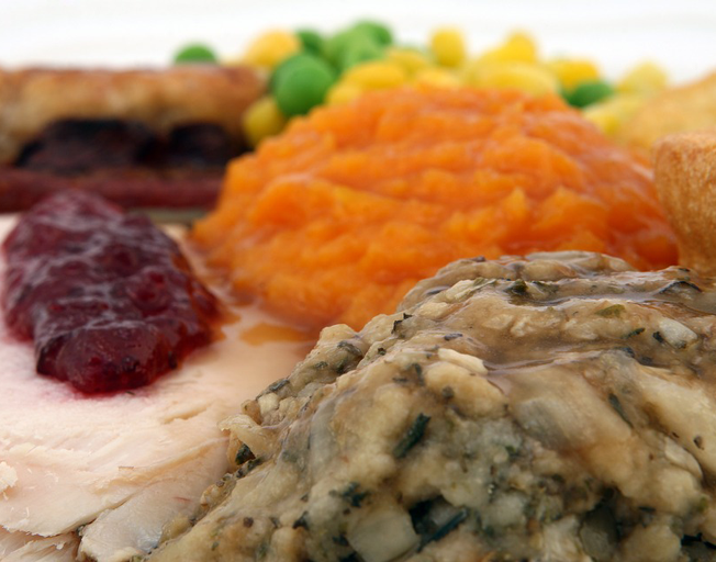 A plate with Thanksgiving food on it