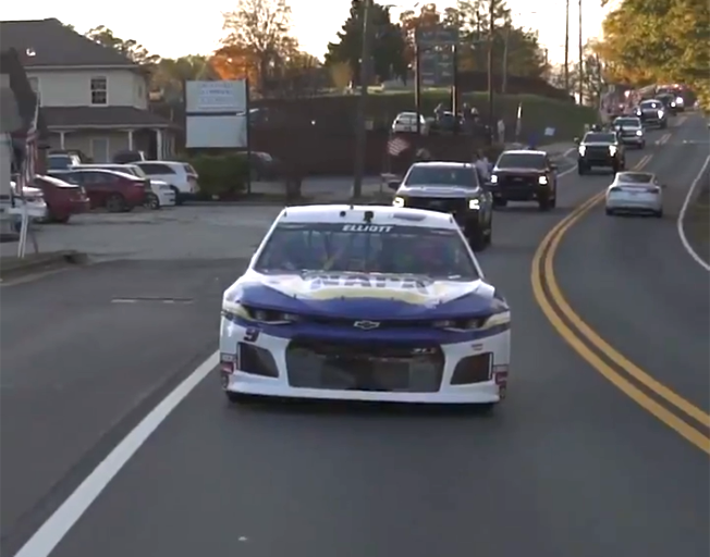 Chase Elliott driving his racecar through Dawsonville, Georgia 11-09-20