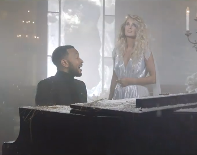 "John Legend and Carrie Underwood in ""Hallelujah"" music video"