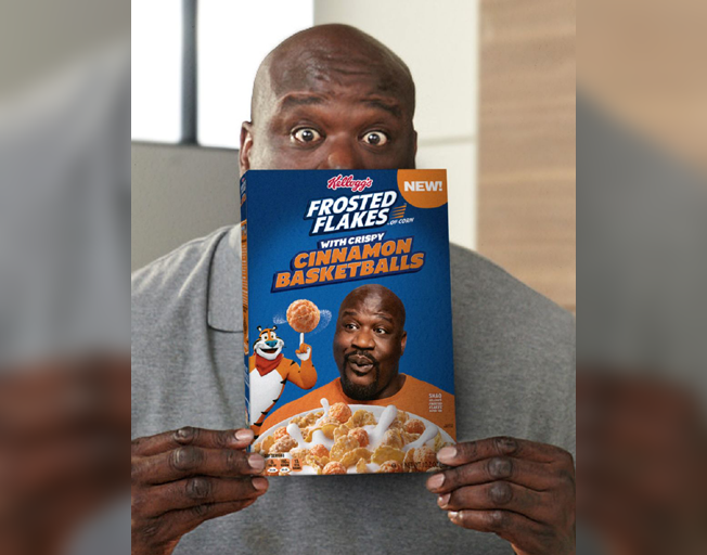 Shaquille O'Neal holding Frosted Flakes with Cinnamon Basketballs box