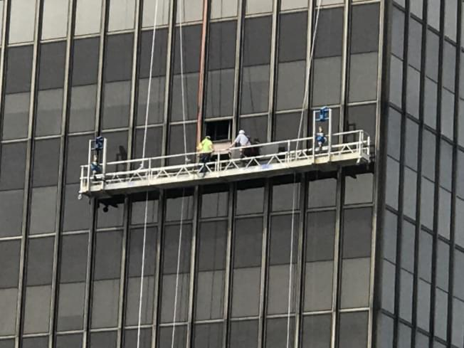 Two workers rescued from malfunctioning scaffolding at State Farm