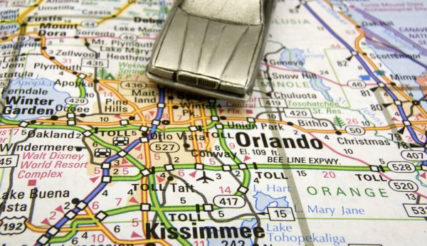 Model sedan on a road map of Orlando and Kissimmee FL