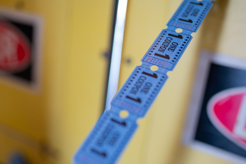 Line of tickets from arcade game center showing one coupon.