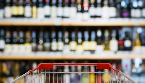 Abstract blur wine bottles on liquor alcohol shelves in supermar
