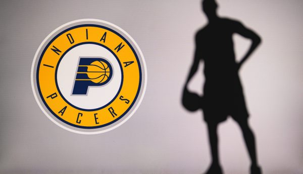 NEW YORK, USA, JUN 18, 2020: Indiana Pacers logo of professional basketball club in american league. Silhouette of basket player in foreground. Sport concept photo, edit space.