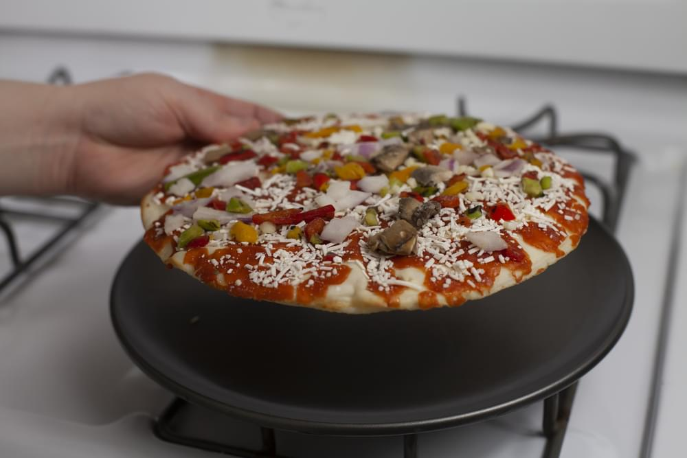 Hand Opening Frozen Pizza