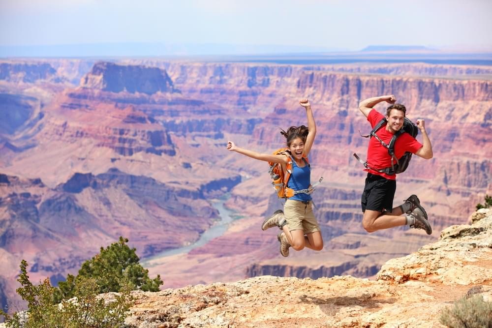 Woman Almost Falls Into The Grand Canyon While Taking A Photo [WATCH]