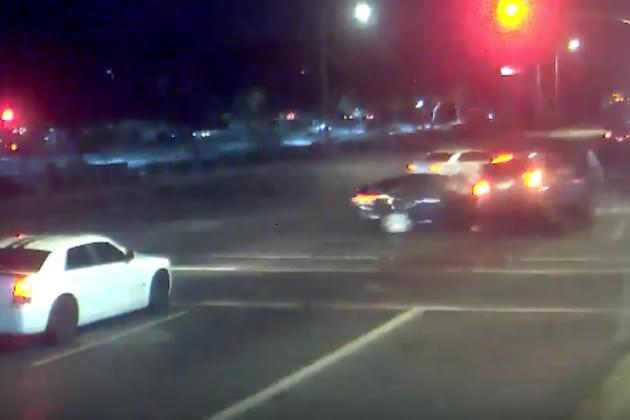This Impaired Driver Ran a Red Light and Almost Hit a Couple Pushing a Stroller [VIDEO]