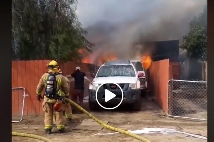 VIDEO: Man Runs Into Burning Building To Save Dog
