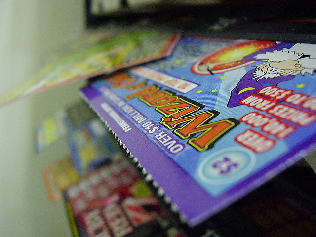2 plead guilty to playing role in lottery scam