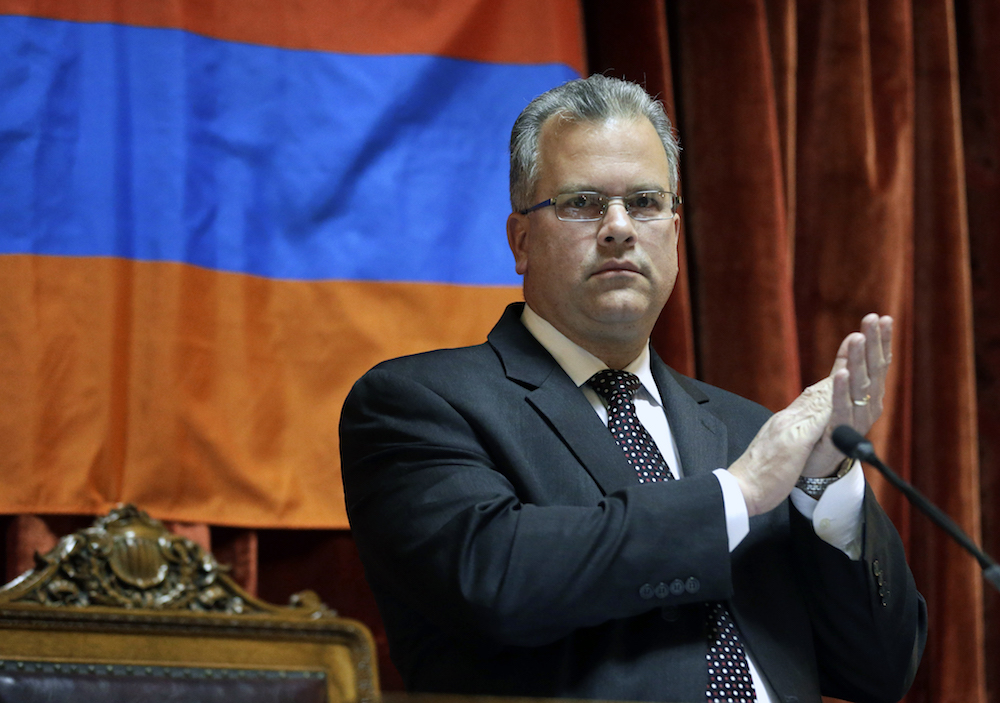 In this April 30, 2014 photo, Rhode Island House Speaker Nicholas Mattiello, applauds as guests are introduced during a recess on the floor of the House Chamber at the Statehouse, in Providence, R.I. Mattiello is a centrist Democrat and former majority leader whose meteoric rise to the position followed the downfall of Gordon Fox. (AP Photo/Steven Senne)