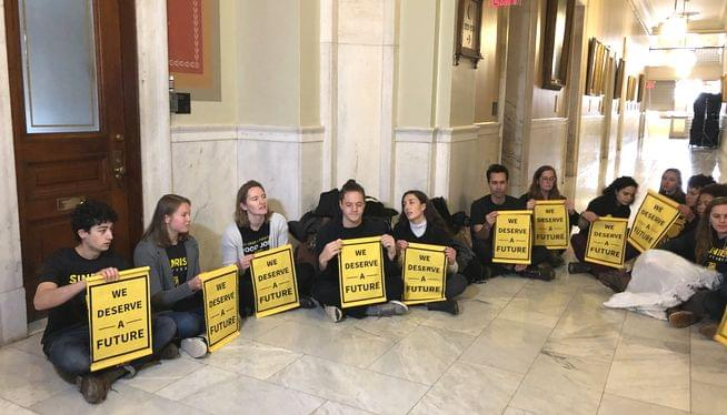 14 climate activists arrested for trespassing at Rhode Island Statehouse